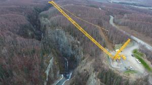 Crane Picking Dozer Into Canyon