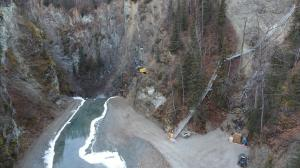 Excavator Being Lowered Into Canyon